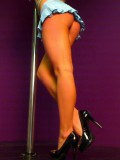 Kate shows off her long sexy legs on the stripper pole in an extremely short skirt